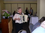 Ms. Kaie Latterner leads everyone in festive song