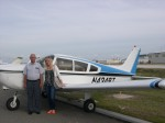 Rein Raja and Kati Rausberg inspect Rein's plane based at Albert Whitted Airport