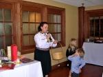 Ms. Marju Cabrera calls out loterii winners, assisted by Annika and Logan Karr, KFES EV96, 21. veeb. 2014, St. Petersburg, FL