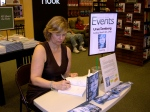 "Urve Tamberg, author of ""The Darkest Corner of the World,"" signs books, Sarasota, Florida, March 9, 2014."