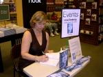 "Urve Tamberg, author of ""The Darkest Corner of the World,"" signs books, Sarasota, Florida, March 9, 2014."
