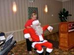 Kaie Põhi Latterner helps Santa unwind after his long sleigh ride, 6 dets 2014, St. Petersburg, FL