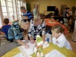 Signing the KFES guest book: Triin Karr, Anneliis Kuusik, and Annika Karr, KFES, 13. nov. 2016, Seminole, FL